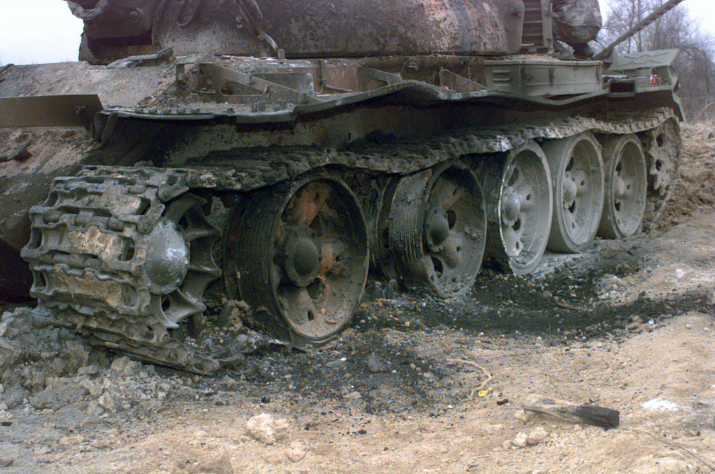 The end result from the blast of C-4 plastic explosive caused excessive damage to the row wheels that had been placed in the turret of the T55 Russian tank, by the Explosive Ordnance Detachment team, on Camp Dobol, Bosnia, during Operation JOINT GUARD. On December 20, 1996, the Implementation Force (IFOR) mission came to a conclusion and the 1ST Infantry Division was selected to continue serving in Bosnia as part of the new Stabilization Force (SFOR). This decision brought to close the peace mission of Operation JOINT ENDEAVOR and has been the beginning for the current operation known as Operation JOINT GUARD. JOINT GUARD will continue to monitor the militaries of the former warring...