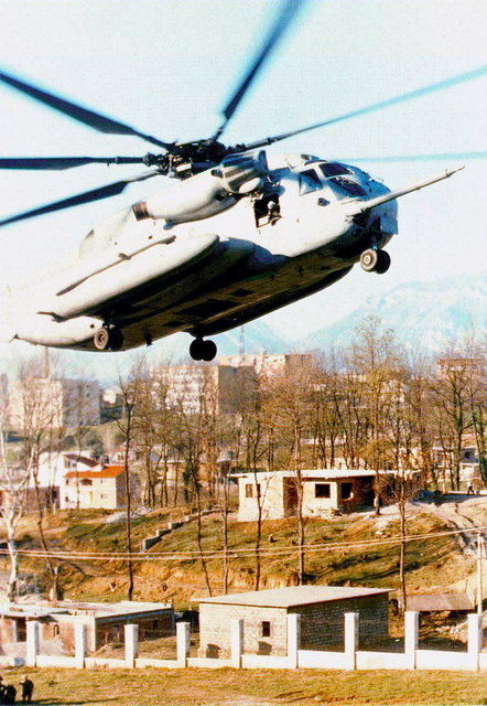 """A CH-53 """"Super Stallion"""", from HMM-365, the 26th MEU's Avaition Combat Element, lands at the evacuation site inside the compound at the US Embassy in Tirana, Albania, during Operation SILVER WAKE. The 26th Marine Expeditionary Unit (Special Operations Capable) was called upon to perform a NEO (Non-combatant Evacuation Operation) of US citizens that desired to leave Albania, due to the current civil strife"""