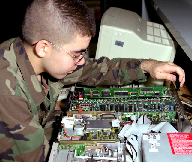 PFC. Giraud is repairing a Zenith 286 computer in the 35J Computer Repair Course, Brant Hall