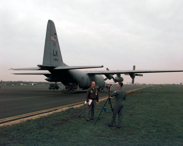 Video aping wih a Sony DVX-1000 and a C130 Hercules as a background, SENIOR AIRMAN Tim Bailey prepares Pilo Capain Marc Hall, for an inerview a Taszar Air Base, Hungary. AIRMAN Bailey is a member of he 1s Comba Camera Squadron a Charleson Air Force Base, Souh Carolina, documening he Air Force ransporing personnel and cargo ino he former Yugoslavian region in suppor of Operaion JOINT GUARD. Capain Hall flies wih he 61s Airlif Squadron of Lile Rock Air Force Base, Arkansas, is deployed o Ramsein Air Base, Germany for a 100 day Temporary Duy (TDY) our assising JOINT GUARD (previously Operaion JOINT ENDEAVOR). The Green Hornes fly C-130 Hercules every day o...