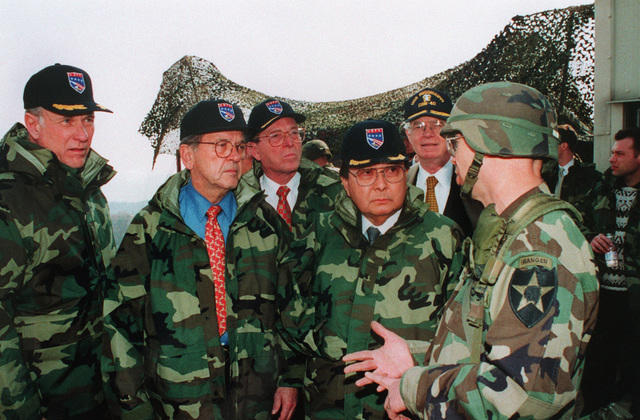 Front row left to right: Senators Pat Roberts (R-KS), Ted Stevens (R-AK) and Daniel K. Inouye (D-HI); second row left to right: Pete V. Dominici (R-NM) and Thad Cochran (R-MS) receive a briefing after a live fire demonstration at the Multiple Purpose Range Complex (MPRC)