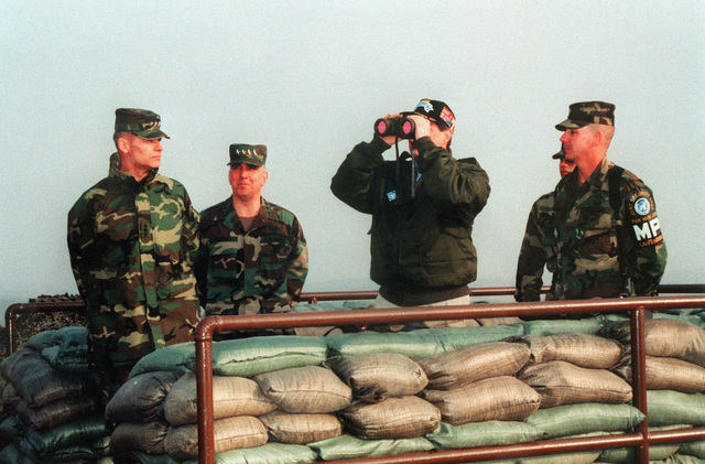 LT. GEN. Richard F. Timmons, CHIEF of STAFF Combined Forces Command, GEN. John H. Tilelli, Jr., Commander in CHIEF ROK-US Combined Forces Command and LT. COL. Laufenberg watch Vice-President Al Gore as he looks through binoculars at the North Koreans from a bunker in the Demilitarized Zone