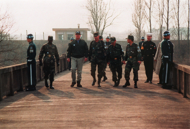 This is the Bridge of NO Return, half of which belongs to North Korea. Vice-President Al Gore walks on the bridge with LT. COL. Laufenberg and other members of the Joint Security Area (JSA)