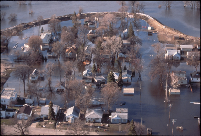 [Severe Storms/Flooding] Grand Forks, ND, April 1, 1997 - Aerial of a flooded Grand Forks neighborhood after the Red River of the North flood waters came though the area.  FEMA/Michael Rieger