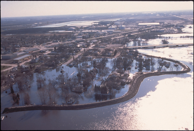 [Severe Storms/Flooding] Grand Forks, ND, April 1, 1997 - Aerial of a flooded Grand Forks neighborhood after the Red River flood waters came though Grand Forks. FEMA/Mike Rieger
