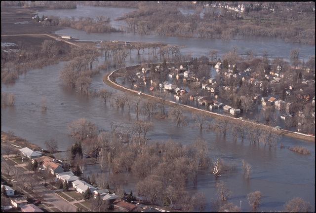 [Severe Storms/Flooding] Grand Forks, ND, April 1, 1997 - Aerial of Grand Forks after the Red River of the North flood waters came though the town. FEMA/Michael Rieger