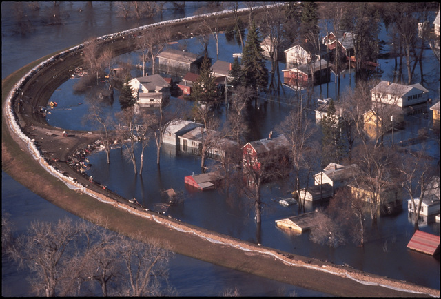 [Severe Storms/Flooding] Grand Forks, ND, April 1, 1997 - Aerial of Grand Forks neighborhood still flooded after the Red River flood waters came though the town. FEMA/Mike Rieger
