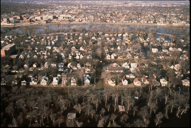 [Severe Storms/Flooding] Grand Forks, ND, April 1, 1997 - Aerial of  Grand Forks, the Red River and a flooded neighborhood. The Red River flooded the area. FEMA/Mike Rieger