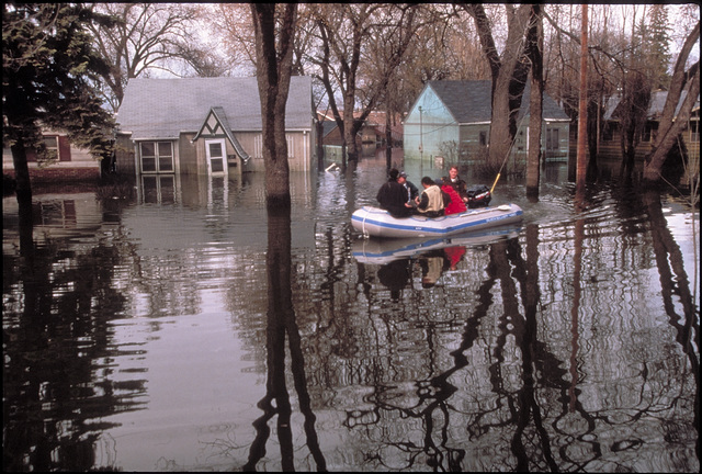 [Severe Storms/Flooding] Grand Forks, ND, April 1, 1997 - Search & Rescue personal go through Grand Fork neighborhoods flooded by the Red River.  FEMA/Michael Rieger