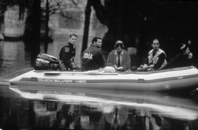 [Severe Storms/Flooding] Grand Forks, ND, April 1, 1997 - Search & Rescue personal in a boat go through Grand Fork neighborhoods flooded by the Red River. FEMA/Michael Rieger