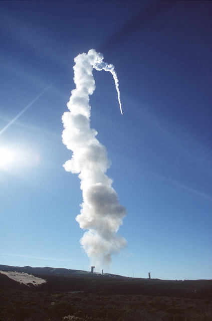 Some thirty seconds after lift-off, a Titan II rocket makes it's way into the upper atmosphere above Vandenberg AFB, Calif. The rocket is carrying the first 5 of the 66 Iridium satellites that will make up the Iridium satellite constellation allowing people to communicate with anyone, anytime, anyplace on earth