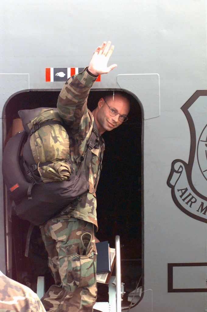 US Army Captain Dan Larsen, waves good-bye as he gets on an Air Mobility Command C-141B Starlifter for the flight home after deploying to Brazzaville, Congo for PHOENIX GAUNTLET. PHOENIX GAUNTLET deployed enabling forces as part of contingency planning to prepare for a possible evacuation of Americans from Zaire, gripped in a civil war. Captain Larsen is with the 1ST Battalion, 10th Special Forces Group from Stuttgart Germany
