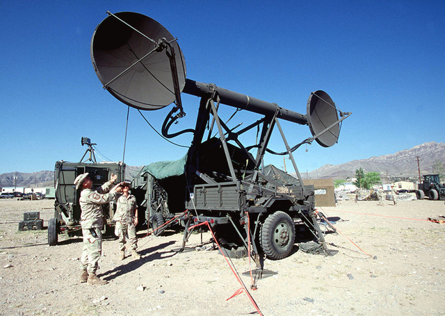 Two Airmen assigned to the 225th Combat Communications Squadron, Martin Air National Guard Station, Gadson, Alabama, adjust the angle of the dish on a TRAC-170 Wideband System. When the TRAC-170 is operational it will provide communication links for Forces Command (FORSCOM) during the world's largest joint service, multi-national tactical air operations exercise