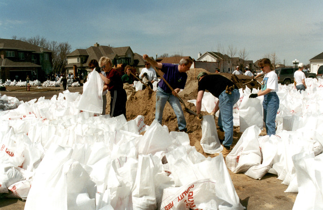 [Severe Storms/Flooding] Fargo, ND, 04/10/1997 -- Sandbagging becomes a community effort as hundreds of residents and volunteers fight the rising waters of the Red River. FEMA/David Saville