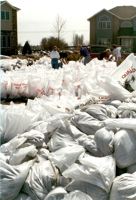 [Severe Storms/Flooding] Fargo, ND, 04/10/1997 -- Sandbagging becomes a community effort as hundreds of residents and volunteers fight the rising waters of the Red River of the North in Fargo, North Dakota. FEMA/David Saville