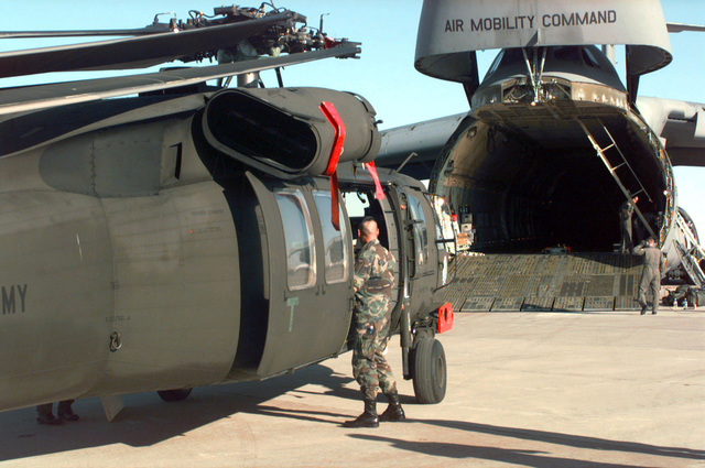 A UH-60 Blackhawk helicopter from the 147th Aviation Battalion, Madison, Wisconsin, sits on the ramp at Biggs Army Air Field after it was offloaded from the C-5 Galaxy. The UH-60 will be transported to a staging area and reassembled and flight checked for use in the world's largest joint service, multi-national tactical air operations exercise. (Duplicate image, see also DFSD0302973 or search 970413F4141A 005)