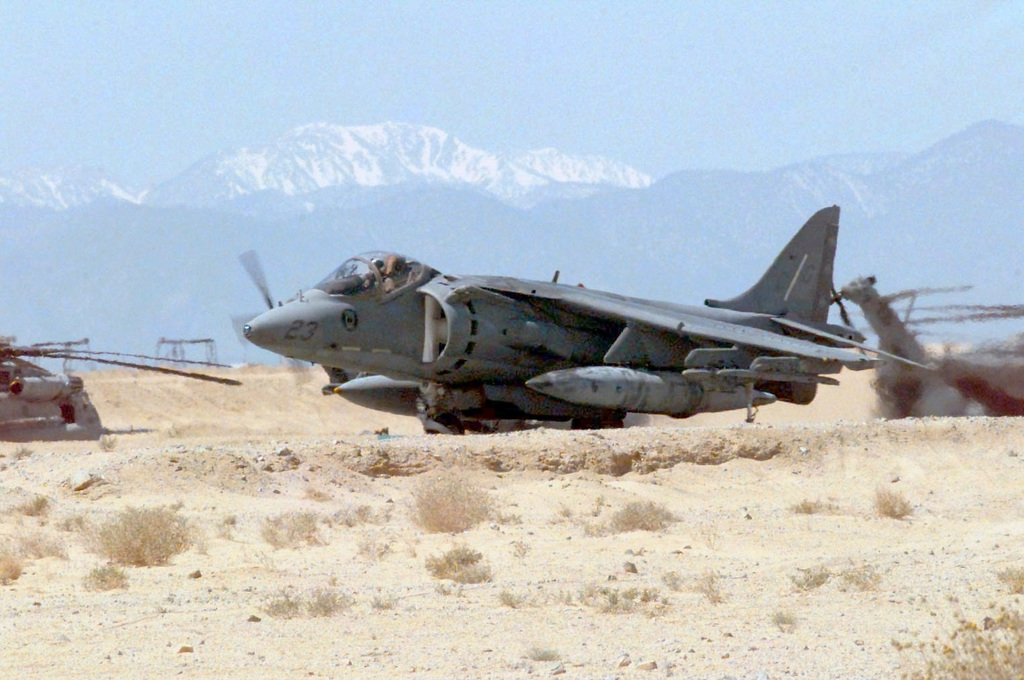 An AV-8B Harrier lands at the air strip adjacent to Camp Wilson during COMBINED ARMS Exercise (CAX) 5-97. The Harrier is used for air to ground and air to air fighting. CAX 5/6-97 is a MAGTF (Marine Air Ground Task Force) exercise being conducted at MCAGCC (Marine Corps Air Ground Combat Center), 29 Palms, California. The command element for this exercise is MAGTF-6, built around the 6th Marine Regiment, 2d Marine Division, Camp Lejeune, North Carolina. Many commands from the II MEF (Marine Expeditionary Force) have sent units to this desert warfare exercise, to fill key billets in the Ground Combat Element (GCE), Air Combat Element (ACE) and the Combat Service Support Element (CSSE)