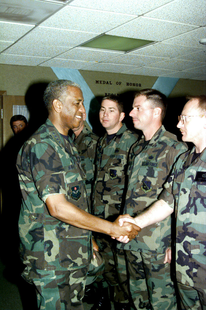 "GEN Lloyd W. ""Fig"" Newton, Commander of Air Education and Training Command (AETC) shakes hands as he visits with Goodfellow NCO Academy instructors during his base orientation tour and briefing"