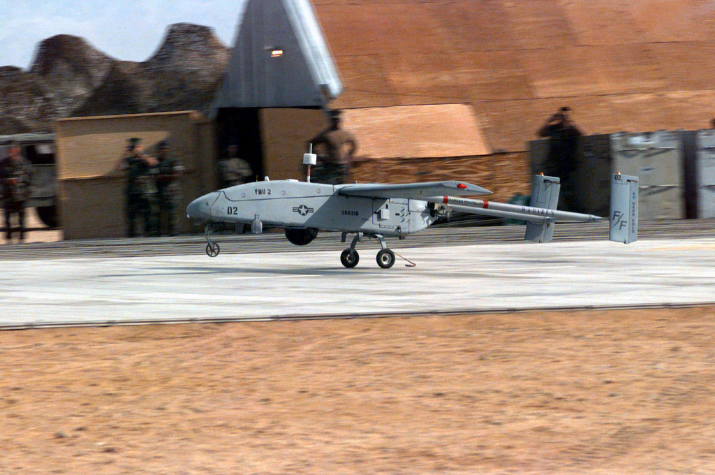 "A ""Night Owl"" from Marine Unmanned Aerial Vehicle (UAV) Squadron-2, lands after a surveillance mission at airfield ""Seagull"" during COMBINED ARMS Exercise (CAX) 5-97. The ""Night Owl"", which replaced the OV-10 aircraft, is capable of providing units with ground reconnaissance, deep air support, mortar/artillery live fire adjustments, and Battle Damage Assessment. The aircraft is controlled by a technician and the use of several satellites. The maximum range of the aircraft is over 50 kilometers. CAX 5/6-97 is a MAGTF (Marine Air Ground Task Force) exercise being conducted at MCAGCC (Marine Corps Air Ground Combat Center), 29 Palms, California. The command element for this exercise is..."