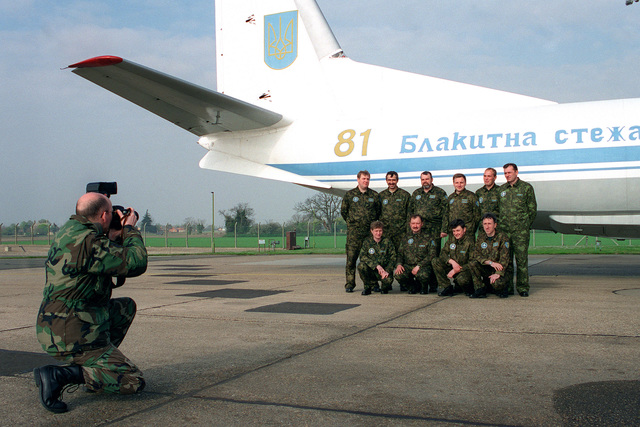 Photographer SSGT James Howard of the 100th Communications Squadron photographs a delegation from the Ukrainian Air Force in front of their aircraft. The Ukrainians stopped at Mildenhall enroute to the United States to participate in the observation/verification of the Open Skies Treaty