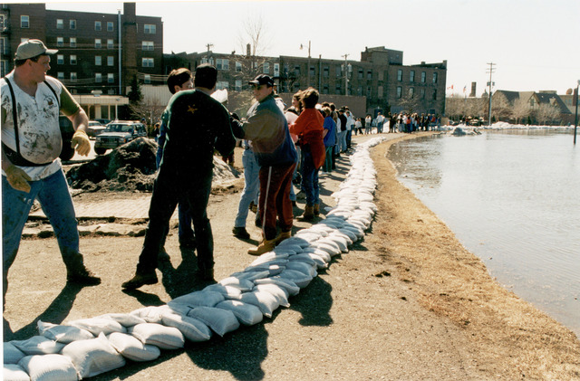 [Severe Storms/Flooding] Grand Forks, ND, 04/15/1997 -- Residents and volunteers build a levee with sandbags to try and protect a neighborhood from the rising water of the Red River of the North. In less than 12 hours Grand Forks will be underwater. FEMA/David Saville