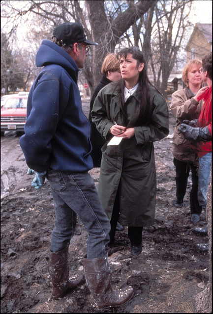 [Severe Storms/Flooding] Grand Forks, ND, April 15, 1997 - A FEMA worker and a resident stand in mud talking.  The Red River flooded many  homes in the area. FEMA/Michael Rieger