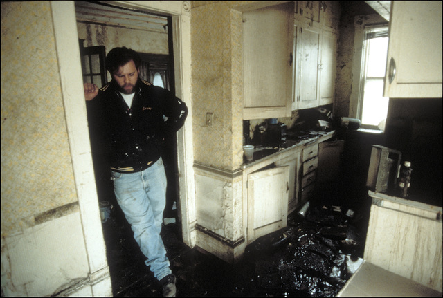 [Severe Storms/Flooding] Grand Forks, ND, April 15, 1997 - A resident looks at the mud and water still  in his home.  The Red River damaged many area homes with mud and water when the Red River flood waters came though Grand Forks. FEMA/Michael Rieger