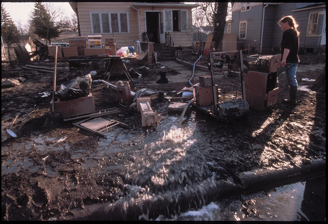 [Severe Storms/Flooding] Grand Forks, ND, April 15, 1997 - Residents of Grand Forks muck out their homes and use pumps to remove water from basements.  The Red River flooded and damaged many homes in the area with mud and water. FEMA/Michael Rieger