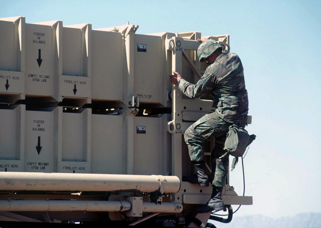 A soldier assigned to Alpha 5-52, Air Defense Artillery (ADA) Brigade, Fort Bliss, El Paso, Texas, makes final preparations for a simulated launching of a Patriot Missile. The Patriot Missile System will be used by the Blue forces to defend against the Red Forces' air attacks during ROVING SANDS '97. ROVING SANDS is a multinational effort and is the largest military exercise on United States soil that allows training in a joint environment to hone command and control procedures and integrate new systems in Theater and Air Missile Defense