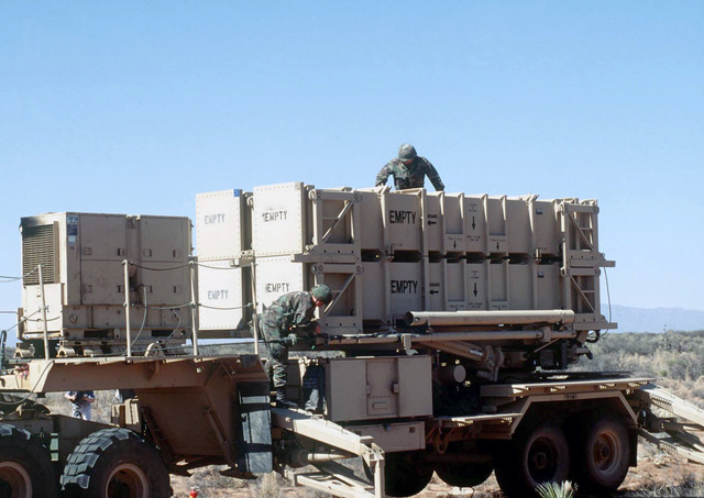 Two soldiers assigned to Alpha 5-52, Air Defense Artillery (ADA) Brigade, Fort Bliss, El Paso, Texas, set up a Patriot Mobile Missile Launcher and ready it for a simulated launch. The Patriot missile system will be used by the Blue Forces to defend against the Red Forces' air attacks during ROVING SANDS '97. ROVING SANDS is a multinational effort and is the largest military exercise on United States soil that allows training in a joint environment to hone command and control procedures and integrate new systems in Theater and Air Missile Defense