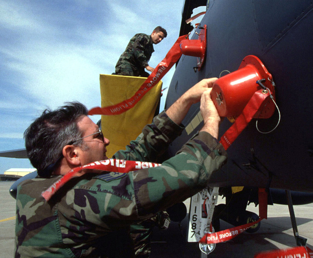 Members of the 336th Fighter Squadron, Seymour Johnson Air Force Base, North Carolina, perform post-flight operations on one of their F-15 Eagles on the flight line. The 336's members and aircraft are deployed to participate in the world's largest joint service, multi-national tactical air operations exercise. (Duplicate image, see also DFSD9900842 or search 970417F2171A004)