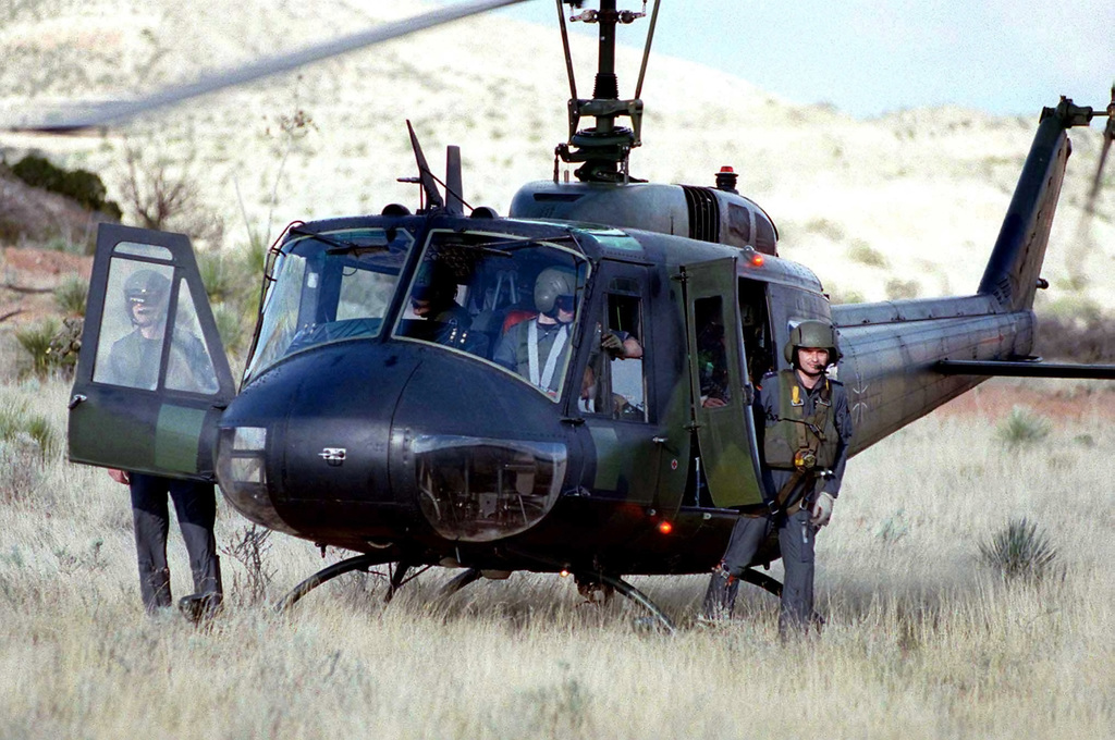 German aircrew with their Bell UH-1B Huey helicopter, Air Transport Squadron 62/CSAR Germany, check out the terrain during a familiarization flight over the Alamogordo bombing range before the start of ROVING SANDS '97. ROVING SANDS is a multinational effort and is the largest military exercise on United States soil that allows training in a joint environment to hone command and control procedures and integrate new systems in Theater and Air Missile Defense