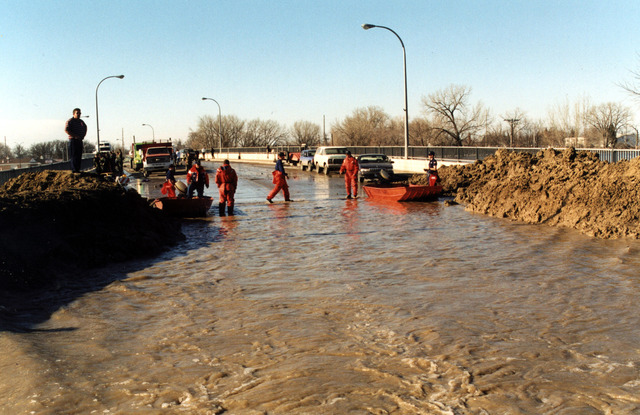 [Severe Storms/Flooding] East Grand Forks, MN, 04/18/97 -- These dikes and sandbags failed to stem the flow of water along the Red River of the North and it's tributaries. The U.S. Coast Guard provided major assistance to the response effort.  FEMA/David Saville