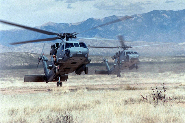 Two SH-60 Seahawk helicopters from the Helicopter Anti-Submarine Squadron North Island, California, move in for a landing near Phillips Hills in the New Mexico desert during a familiarization flight for the joint service exercise, ROVING SANDS 97. The mission will include a search for Scud missile sites in the Alamogordo Bombing Range. The SH-60 helicopters are participating in the exercise as part of the Red Forces. ROVING SANDS is a multinational effort and is the largest military exercise on United States soil that allows training in a joint environment to hone command and control procedures and integrate new systems in Theater and Air Missile Defense