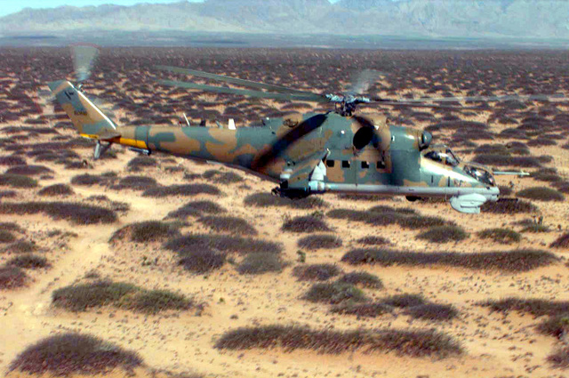 A MI-35P Hind, Russian attack helicopter flies low over Dona Ana Range, Fort Bliss, Texas. The MI-35Ps are operated by members of Optec Threat Support Activity, Biggs Army Airfield, Texas during the world's largest joint service, multi-nation tactical air operations exercise