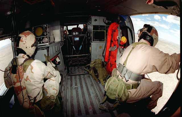 Aviation Warfare Systems Operator CHIEF PETTY Officer (AWC) Paul Schenk (left) and Aviation Warfare Systems Operator Secound Class (AW2) Steve Ayers (right), Navy SH-60 Seahawk helicopter crew chiefs, go through their final checks before taking off on a familiarization flight for exercise ROVING SANDS '97. The mission will include a search for Scud missile sites in the Alamogordo Bombing Range. The airmen and the helicopter are from the Helicopter Anti-Submarine Squadron, North Island, California, are participating in exercise ROVING SANDS as part of the Red force. ROVING SANDS is a multinational effort and is the largest military exercise on United States soil that allows training in a...