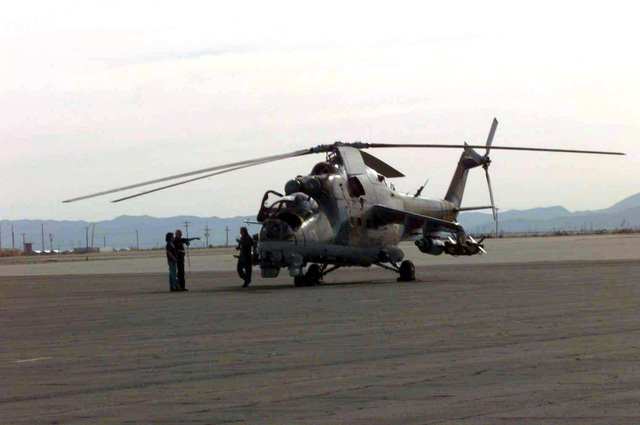 Crew chiefs ready a MI-35P Hind, Russian attack helicopter for a attack mission against various air defense sites at Dona Ana Range, Fort Bliss, Texas. The MI-35Ps are operated by members of Optec Threat Support Activity, Biggs Army Airfield, Texas during the world's largest joint service, multi-nation tactical air operations exercise