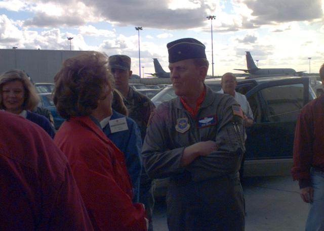 Brigadier General Kenneth Hess, Commander of Grand Forks AFB, North Dakota, talks with Red Cross President Elizabeth Dole, during her visit to the shelters of the flood victims. Due to extensive flooding in the city of Grand Forks, nearly 3,000 residents were forced to evacuate their homes and are temporarily housed at hangers at the base