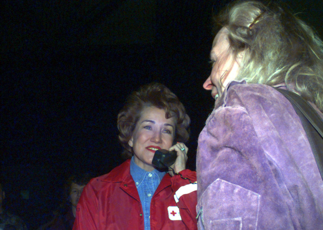 Crystal Harris, a victim of the flood damage at Grand Forks, North Dakota, watches as Red Cross President Elizabeth Dole reports on the efforts to help Crystal through this crisis to Crystal's mother