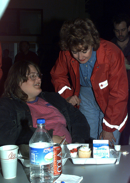 Elisabeth Dole, President of the Red Cross, talks with Luella Hanson, a flood victim of Grand Forks, during her visit to a temporary shelter at Grand Forks AFB, North Dakota. The shelter is temporarily housing nearly 3,000 Grand Forks residents