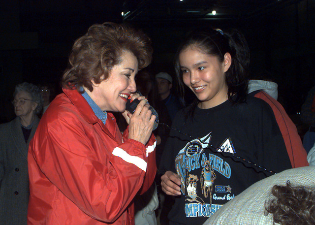 Elizabeth Dole reassures family and friends that the Red Cross is taking care of the Flood Victims during her visit to a temporary shelter at Grand Forks AFB, North Dakota. The shelter is temporarily housing nearly 3,000 Grand Forks residents
