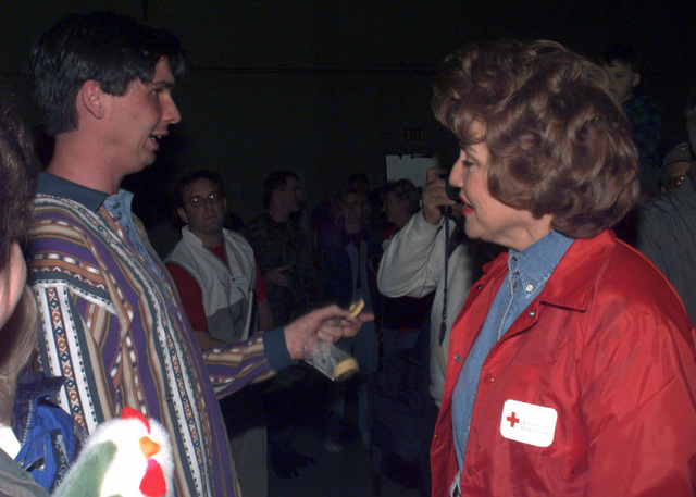 Gary Godorou, a flood victim of Grand Forks, North Dakota, thanks Red Cross President Elizabeth Dole for the efforts of the Red Cross during her visit to Grand Forks, AFB