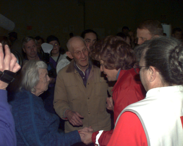 Red Cross President Elizabeth Dole is greeted by flood victims Elsie and Frederick Fried upon entering a shelter for people who have lost their homes to the massive flooding in Grand Forks, North Dakota. Grand Forks AFB is housing nearly 3,000 people during this disaster