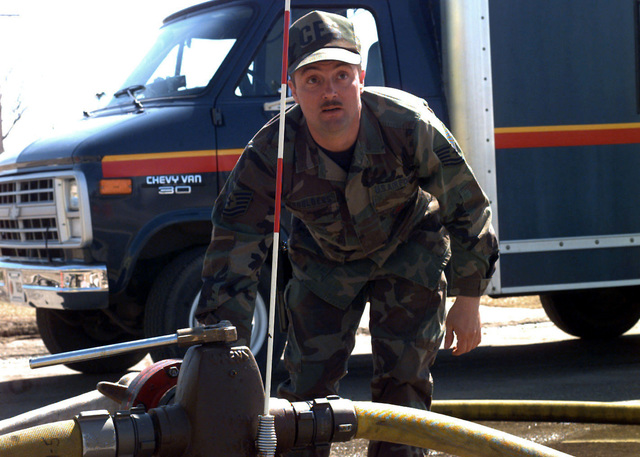 Technical Sergeant Brad Shoulders of the 319th Civil Engineer Squadron/Fire Department supplies Grand Forks AFB, North Dakota, with its one-millionth gallon of water. Due to the flooding of the Red River, the base has had a severe shortage of fresh potable water
