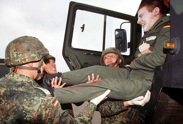 A simulated casualty of an accident is removed from the vehicle by medical personnel, from the German Air Force Rescue Center #1, during a mass casualty exercise at Dona Ana Range, Fort Bliss, Texas. The German soldiers, are demonstrating their rescue techniques to the U.S. Army's 396th Combat Support Hospital personnel from Orogrande, New Mexico, while participating in the world's largest joint service, multi-nation tactical air operations exercise