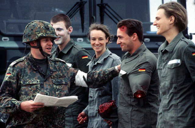 German soldiers in mock injuries are introduced by their commander Lieutenant Colonel Ziegeltrum, Commander of the German Air Force Rescue Center #1 prior to their participation in a mass casualty exercise at Dona Ana Range, New Mexico, on April 25, 1997. The Germans were demonstrating their rescue techniques to members of the United States Army's 396th Combat Support Hospital, Orogrande, New Mexico, during ROVING SANDS '97. ROVING SANDS is a multinational effort and is the largest military exercise on United States soil that allows training in a joint environment to hone command and control procedures and integrate new systems in Theater and Air Missile Defense