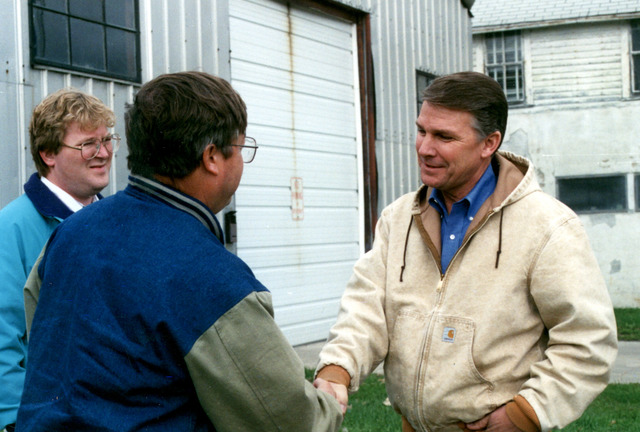 [Severe Storms/Flooding] East Grand Forks, MN, 04/25/1997 -- FEMA Director James Lee Witt speaks with a flood survivor in East Grand Forks, MN.  FEMA/David Saville