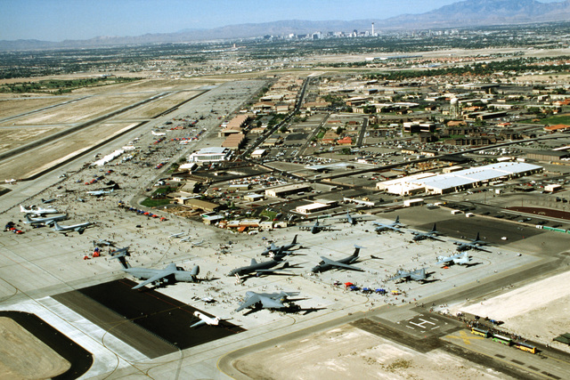 A mid-morning aerial view of the Nellis AFB ramp areas packed with visiting display aircraft during the United States Air Force's 50th Anniversary and Air show