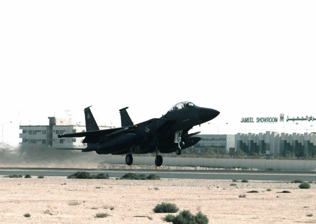 An F-15 Eagle from Seymour Johnson AFB, North Carolina, takes off from the Doha International Airport, Qatar, for a morning sortie during Operation SOUTHERN WATCH. SOUTHERN WATCH enforces the United Nations Security Council Resolution 688 that establishes a no-fly zone over Southern Iraq below the 32nd parallel