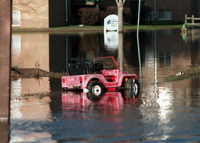 As the flood waters of the Red River recedes, remnants of residents' belongings start to reappear. The Red River rose to slightly over 54 feet in Grand Forks, North Dakota, and East Grand Forks, Minnesota, leaving many people homeless for many days. (Substandard image)
